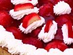 Fresas con nata en un pastel