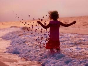 Postal: Mariposas en la playa