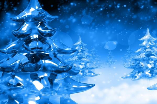 Postal para Navidad con árboles y nieve