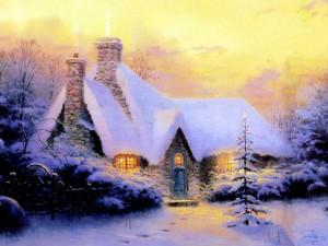 Casita iluminada cubierta con nieve