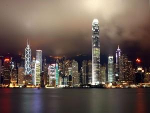 Postal: Vista nocturna del distrito financiero de Hong Kong
