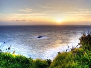 Mirando el mar y el amanecer