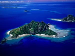 Postal: Vista aérea de islas en el océano