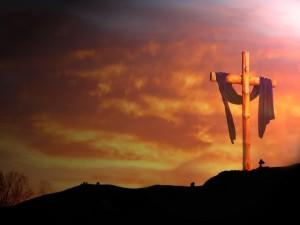 Atardecer y una cruz de madera