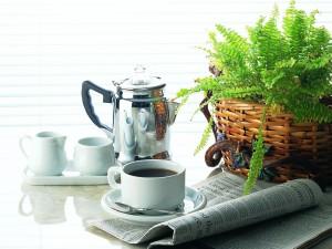 Taza de café y el periódico