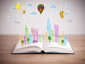 Postal: Ciudad sobre un libro abierto