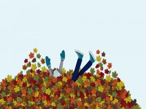 Jugando entre las hojas otoñales