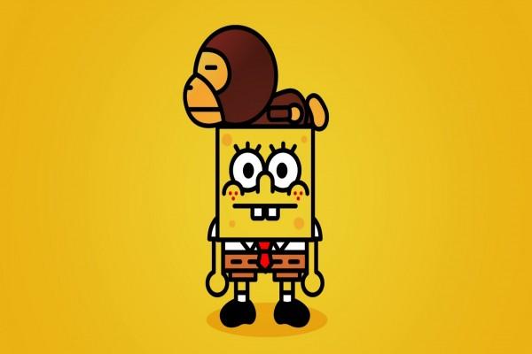 Bob Esponja con un mono en la cabeza