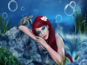 Postal: Sirena sobre la roca