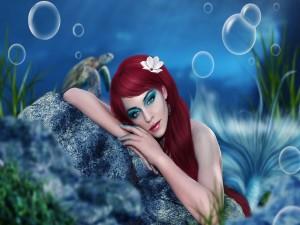 Sirena sobre la roca