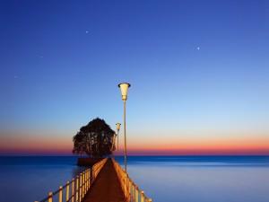 Postal: Cielo con estrellas sobre el mar