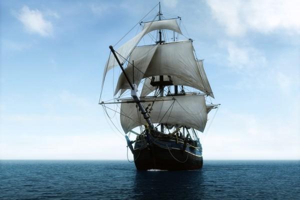 Barco negro en el mar