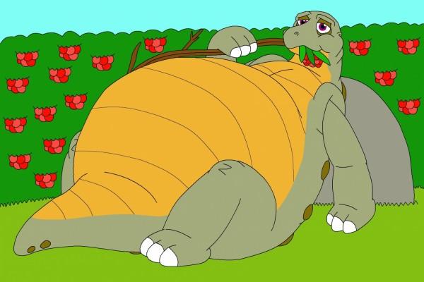 Dinosaurio tumbado y comiendo