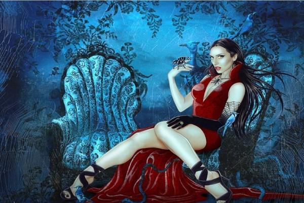 Vampiresa con una tarántula en su mano