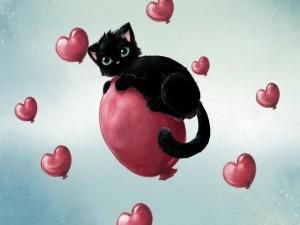 Gatito negro en un globo de aire