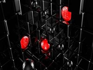 Esferas negras y rojas sobre cubos
