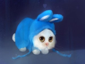 Gatito con disfraz de conejo