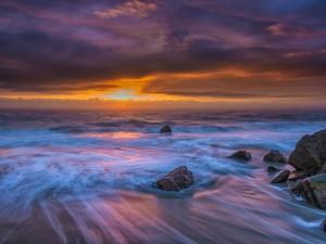 Postal: El mar y el cielo al atardecer