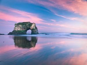 Postal: El cielo reflejado en la arena de la playa