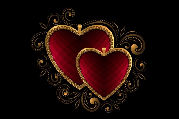 Dos colgantes con forma de corazón