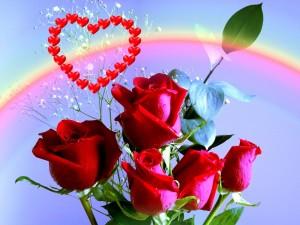 Rosas rojas, y un corazón entre el arcoíris del amor