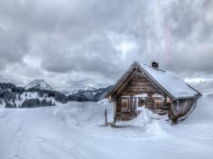 Postal: Cabaña en la nieve
