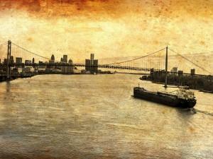 Un gran barco acercándose al puente