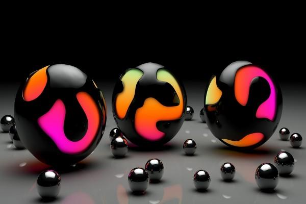 Esferas negras luminosas y canicas