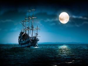 Embarcación a la luz de la luna