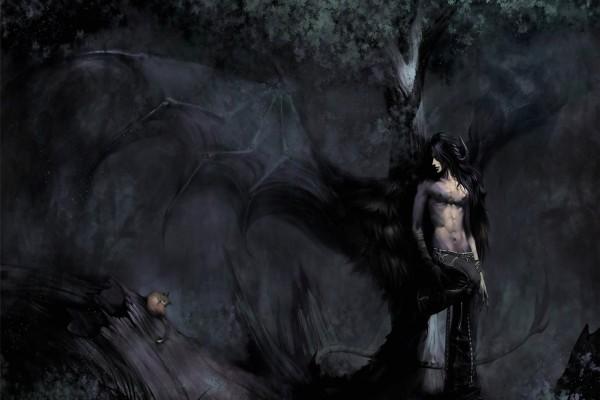 Ángel negro observando a un gatito