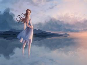 Muchacha en el río, con los rizos movidos por el viento