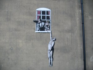 Hombre desnudo, obra del artista Banksy
