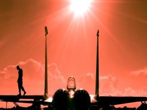 Postal: Rayos de sol sobre el avión y el piloto