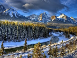 Postal: Vía de tren en un entorno nevado