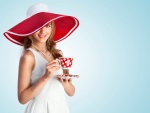 Bella mujer tomando té