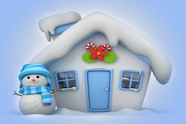 Muñeco de nieve junto a su pequeña casita