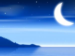 Estrellas y luna sobre el mar iluminado