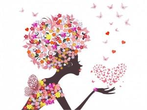 Postal: Mujer primaveral con un corazón de mariposas sobre la mano