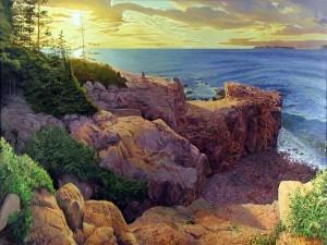 Postal: Los rayo del sol iluminan las rocas y el mar