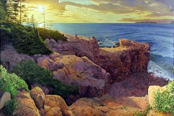 Los rayo del sol iluminan las rocas y el mar