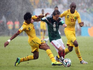 Partido bajo la lluvia México vs Camerún 2014