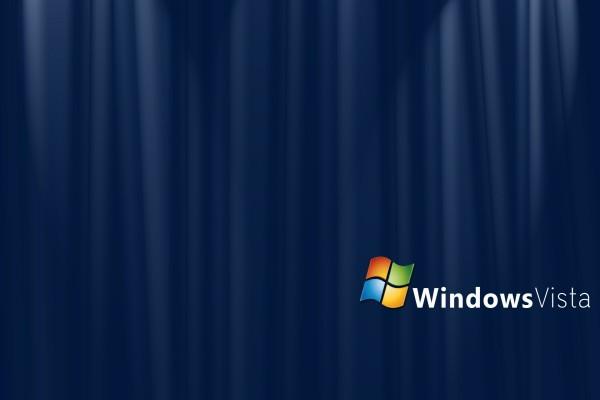 Windows Vista en un fondo azul oscuro