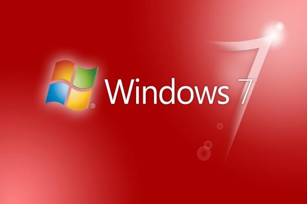 Windows 7 y logo en fondo rojo