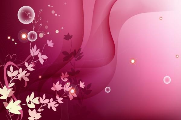 Ramas con hojas en un fondo rosa