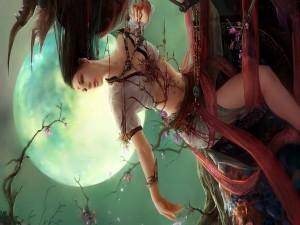 Hada colgada en el árbol