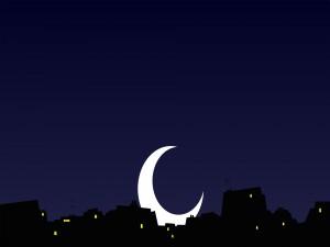 Postal: La luna detrás de las casas