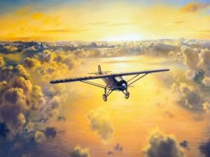 Avioneta cruzando el cielo sobre las nubes