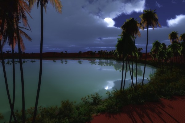 La luna llena entre las nubes reflejada en el agua