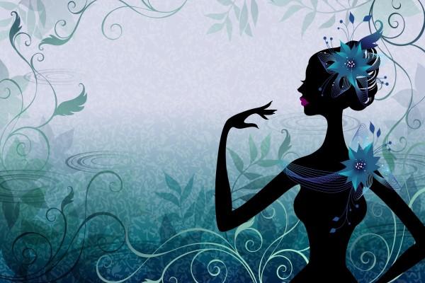 Elegante mujer con una gran flor en el pelo y hombro