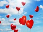 Globos rojos con forma de corazones